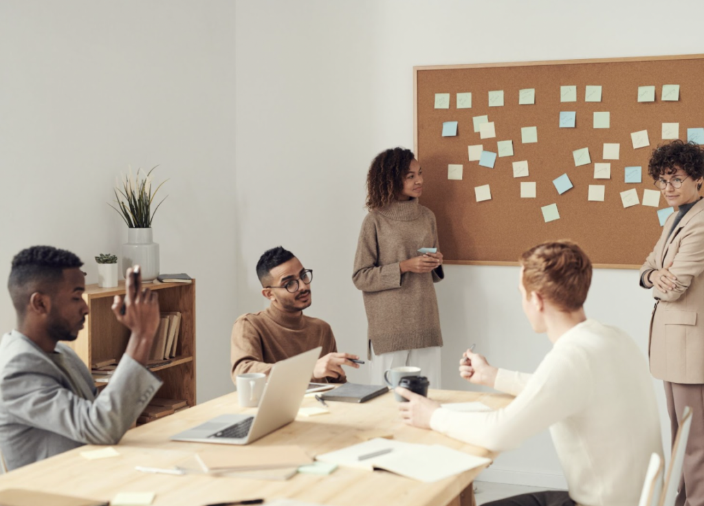 Employees brainstorming with sticky notes
